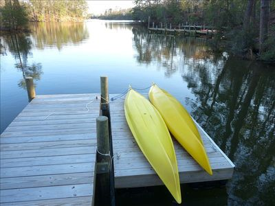 Kayaks available for our guests and view of Moore's Creek from our dock.