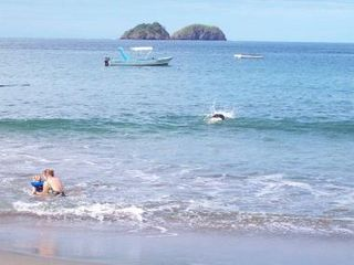 Playa Hermosa villa photo - This is me in the water with my 1 1/2 year old grand daughter. She loved it.