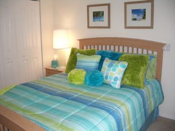Queen-size guest room with lanai/pool access