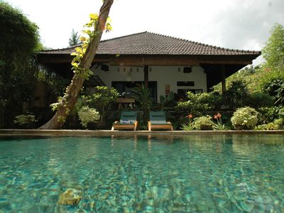 Secluded villa with pool and extensive riverside tropical gardens