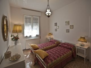 Bologna apartment photo - The Red Bedroom. IL NESPOLO is ideal for a family with children.