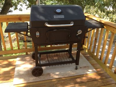 Charcoal grill (setting on a piece of concrete board) purchased in 2012.