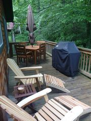 Swannanoa cabin photo - upstairs deck with grill and table seats 4