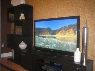 Sunny Isle condo photo - Living Room Entertainment with 52in flatscreen and Bluray