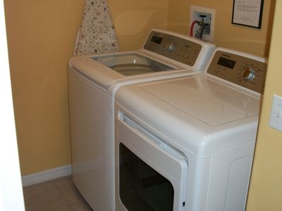 Brand New Oversized Washer and Dryer located just off the kitchen
