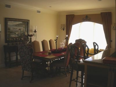 Formal dining room seats 8 at the large dining table and 3 at the breakfast bar
