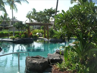 Resort-style lava rock pool, spa and fitness center seen from master lanai
