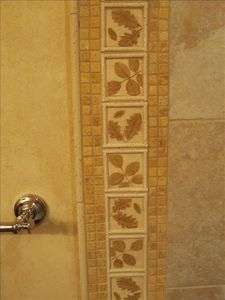Custom bathroom tile with a nature theme