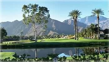 View of golf course and mountains from the backyard