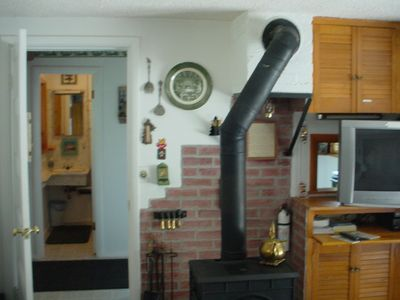 Wood stove w 50' Flat Screen TV
