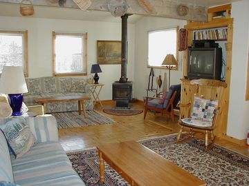 Large living room w/ woodstove, sat-TV, DVD player