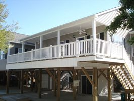 Porch fans over nice large deck.....little glimpse of the ocean too!!!