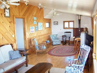 Plum Island house photo - 2nd floor living room with wood stove with 2 picture windows overlooking ocean