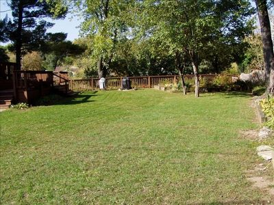 Huge yard with campfire pit, charcoal grill, gas grill, lots of seating on deck.