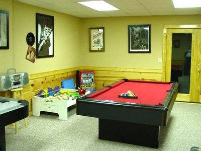 Game room with pool table, air hockey, electronic darts, and kids toys