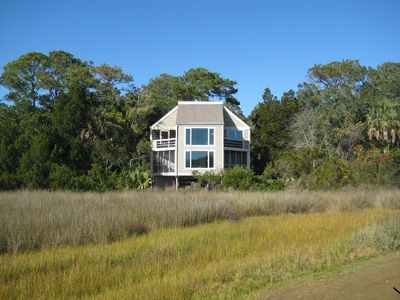 1/2 acre lot backs up to marsh, less than a mile to North or Pelican Beach