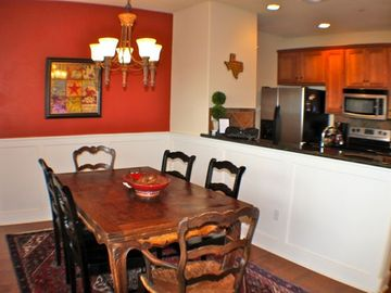 Dining area with comfortable seating for six.