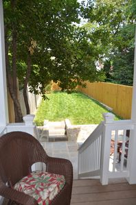 After a long day, relax on the deck overlooking the rear patio & garden