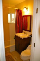 Cardiff by the Sea cottage photo - Bathroom with shower and bathtub for freshing up after the beach