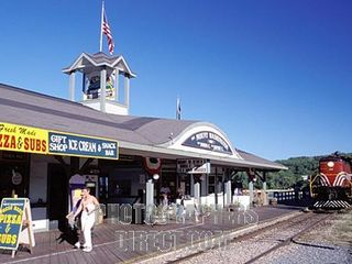 Weirs Beach condo photo - The boardwalk boasts ice cream, arcades, train and boat rides, and boat Rentals