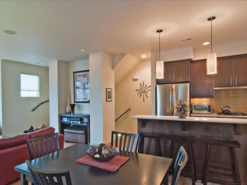 Open, Spacious floor plan with kitchen, breakfast bar, dining and living room