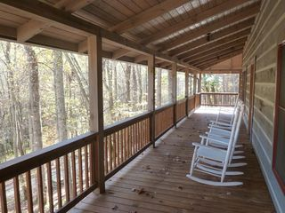 Hot Springs cabin photo - Rocking chairs are awaiting you.