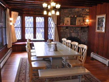 Oversized farm style table, plus the window seat and fireplace.