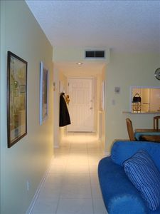 Clean, white tile floors throughout.  Bright and cheerful spaces