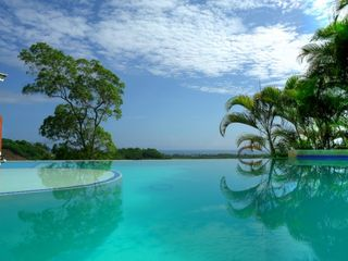 Las Terrenas villa photo - INFINITY POOL VIRTUALLY CASCADING INTO THE OCEAN