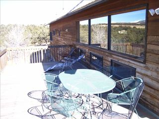Salida house photo - Part of wrap around deck showing picture windows facing west.