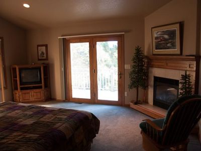 Master upstairs bedroom,king size bed, a balcony, stting area, fire place