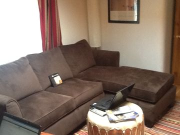 Comfortable sofa in living room for watching TV or Videos.