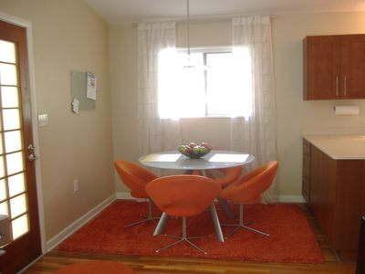 Sputnik inspired dining on an orange shag wool rug.