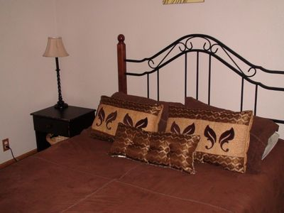 View of downstairs bedroom - one of three - queen size bed in each of the three.