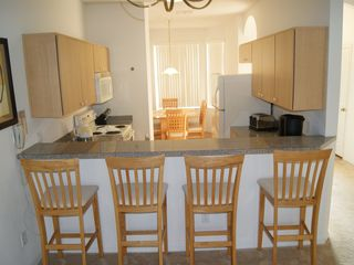 Fiesta Key townhome photo - Kitchen with breakfast bar & dining in the window at rear