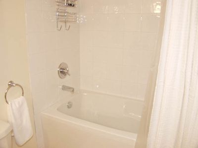 Good sized bathroom with deep soaker tub, heated floors and granite counter top