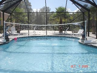 Gulf Shores house photo - Enjoy Aqua Volley in this screened in Saltwater, Heated Gunite Swimming Pool