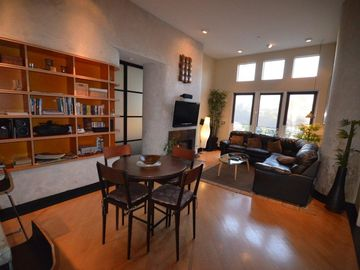 "Irvine condo rental - 14 ft ceilings, spacious Living Area with Leather Couch, 47"" Internet HDTV"