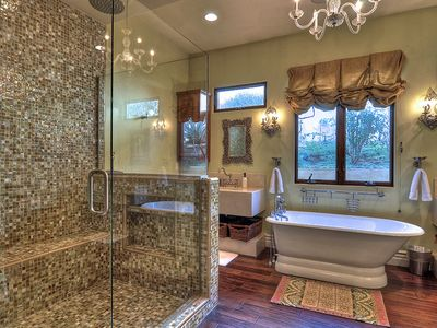 Private master bathroom with large shower and soaking tub.