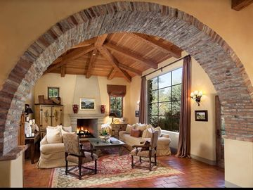 Montecito estate rental - Living room with fireplace and mountain views!