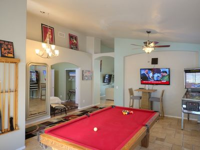 Pool table, 50 inch flat panel tv with wii, and bistro table. Pinball in corner