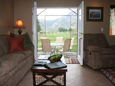 Leavenworth chalet rental - The living area is large with sweeping views of Voilà! vineyards in background.