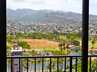 Waikiki condo photo - Living room/ Lanai view of the Ala Wai Canal and beautiful Pololu Valley