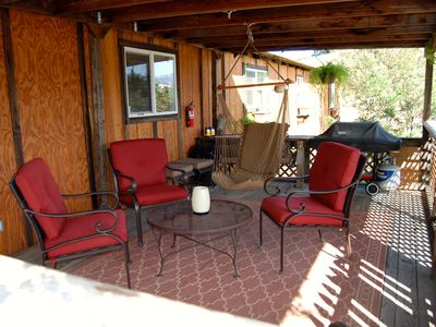The covered porch, BBQ and swing