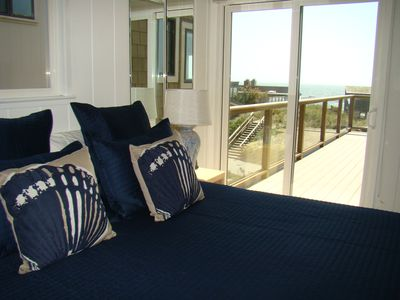 Master bedroom upstairs with view of ocean