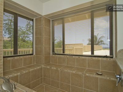 Luxurious master shower, as you look right out to the Pacific Ocean