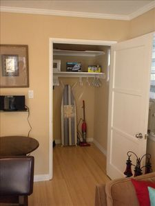 Additional walk in closet, storage area with ironing board, iron.