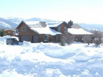 View of House, Three-car Garage, and Teton snowy abundance from Cobblecrest Rd.