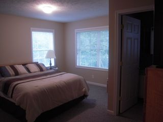 Master Bedroom with attached full bathroom - Petoskey condo vacation rental photo