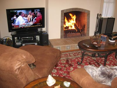 Enjoy the plasma HDTV and the warmth of the fireplace.